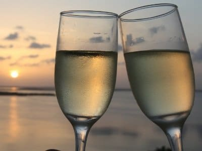 Flutes of champagne with sunset background400x300