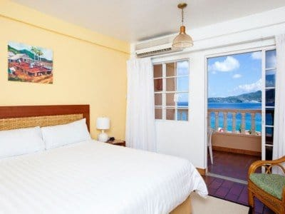 Grenada_Flamboya_Deluxe-room-King-Bed_800x600