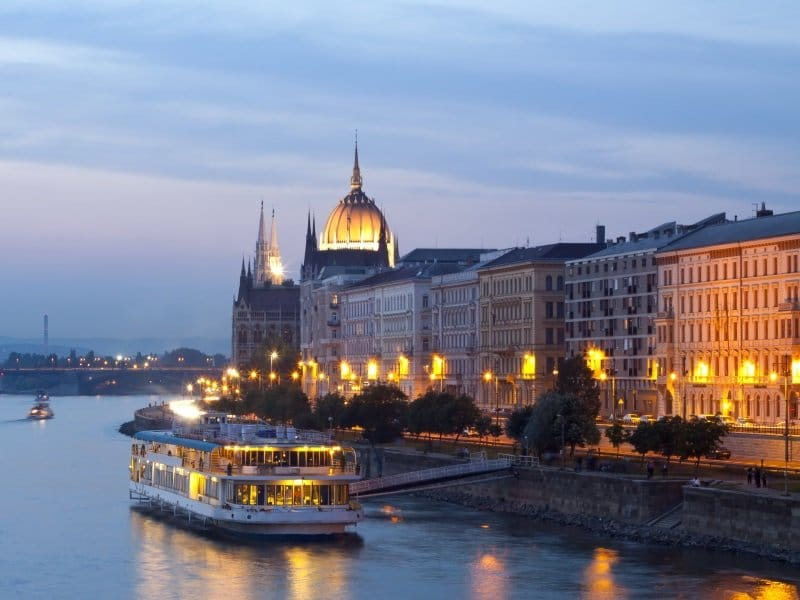 Budapest_Night view of Budapest with small cruise boat_800x600