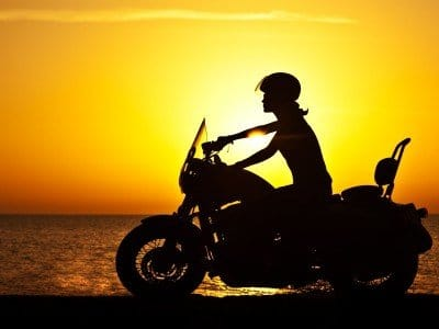 Motor_Woman biker over sunset, female riding motorcycle, motorbike driver traveling, girl racing on the beach road, freedom lifestyle_800x600